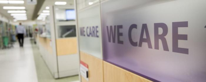 We care vision statement on cubicle glass in the emergency department.
