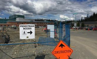 Construction vehicles work to prepare new visitor parking at WGH